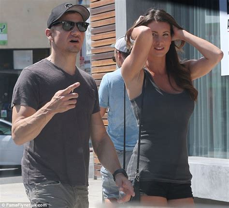 Jeremy Renner Takes Stunning Curvy Brunette Out For