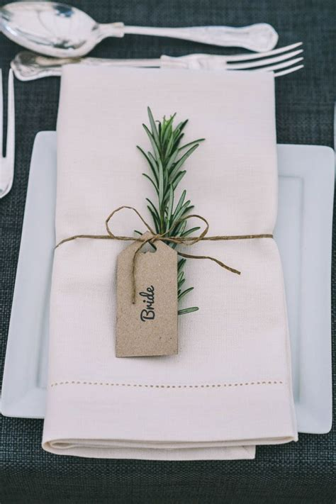 rosemary accented wedding place name setting attached with