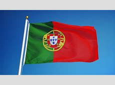 Portuguese Flag Waving In Wind With Clouds In Background