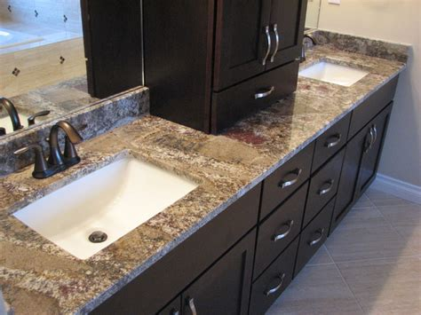 chocolate bordeaux granite on cherry espresso cabinets