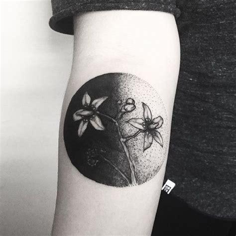 black circle flower tattoo