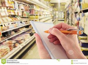 Hand With Pen Writing Shopping List In Supermarket Royalty ...