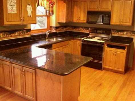 honey colored kitchen cabinets honey oak kitchen cabinets with black countertops 4322