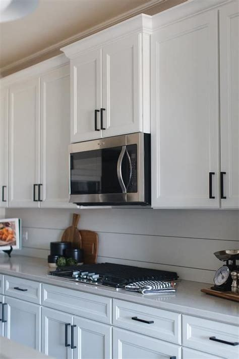 White Cabinets Bronze Hardware by White Shaker Kitchen Cabinets Accented With Rubbed