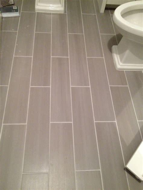 floor tile designs for bathrooms guest bath plank style floor tiles in gray