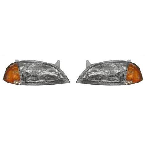 1995 97 geo metro pontiac firefly headlight pair