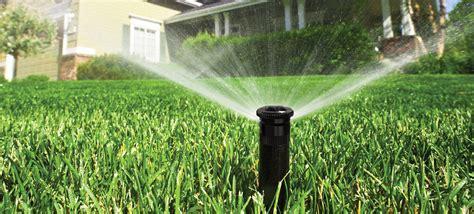 landscaping sprinklers front lawn under fire