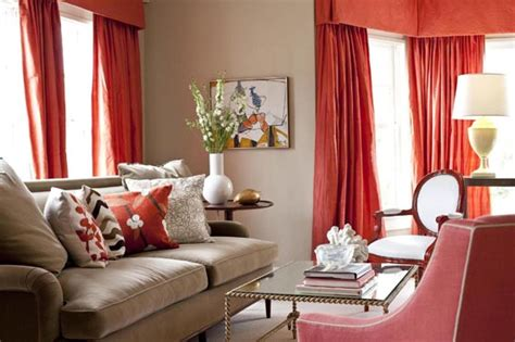 beige and coral red living room with red curtains and