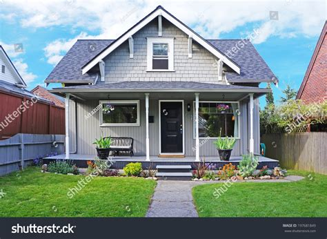 Small Old House Entrance Porch Decorated Stock Photo