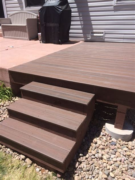 small deck added to extend concrete patio veranda