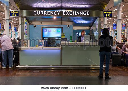 birmingham airport bureau de change exchange kiosk at an airport departure lounge stock