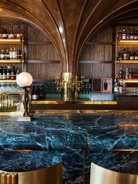 stunning art deco style bar  dark marble counter top