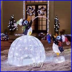 led lighted igloo  fishing penguins sculpture