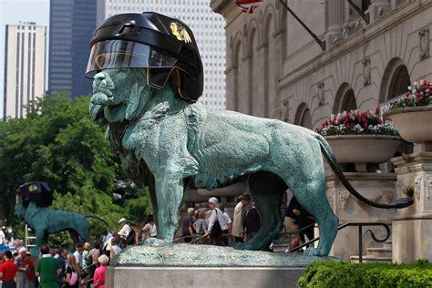 art institute lions  sport blackhawks helmets