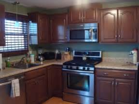 Restaining Kitchen Cabinets With Polyshades by Restain Laminate Cabinets Before And After Home Design Idea