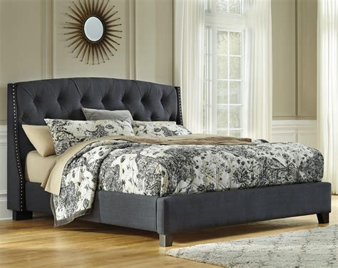 gray upholstered headboard upholstered bed in gray with tufting and