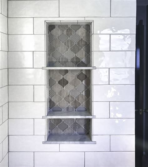 arabesque tile shower shelf niche white subway shower tile