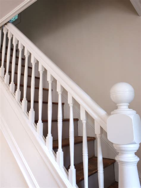 painting a banister white carpeted stairs white baluster all white stairs