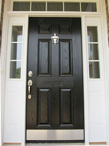front door option love  nickel hardware  kick plate black front doors painted