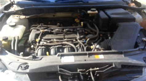 service manual   replace thermostat    mazda