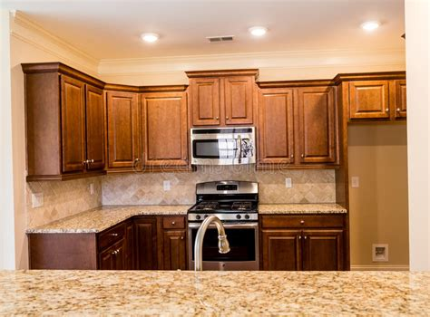 kitchen cabinets with light countertops wood cabinets and granite countertops stock photo 9536