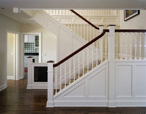 Craftsman or Mission style staircase. Knee wall, white and