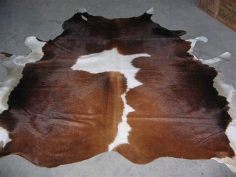 bruin koeienkleed koeienhuid bruin echt leer leder huiden en vachten
