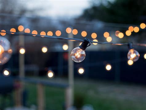 outdoor patio string lights how to hang outdoor string lights from diy posts hgtv