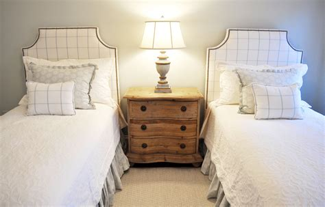 Twin Bed Bedroom With Upholstered Headboards And Blue And