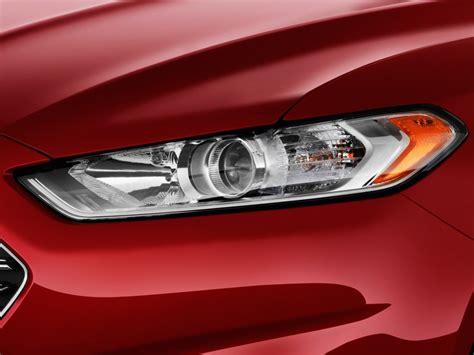 image 2013 ford fusion 4 door sedan se fwd headlight