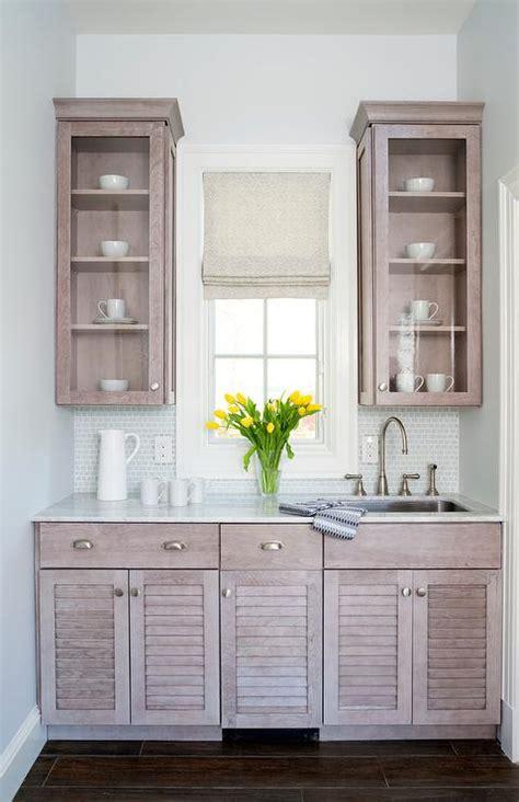 gray wash butler pantry cabinets  silver backsplash
