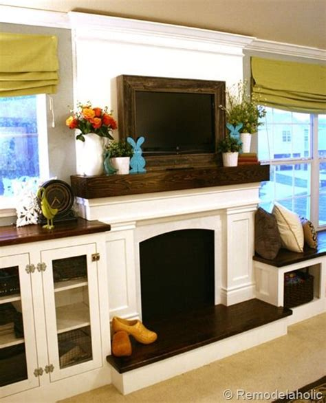 stacked kitchen cabinets fireplace and mantle with a frame around the tv use 2457