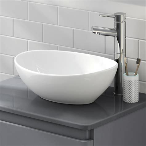 modern bathroom counter top ceramic white basin cloakroom