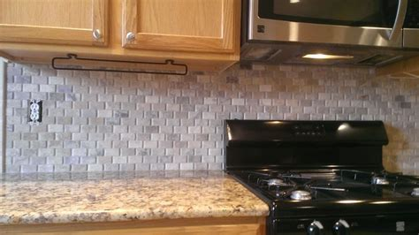 how to hang a kitchen cabinet how to install a tile backsplash without thinset or mastic 8669