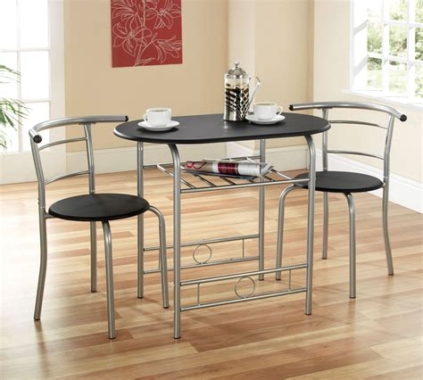 Small Oval Black Wooden Dining Table With Round Chairs Of