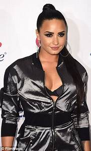 Demi Lovato flashes her bra at Jingle Ball | Daily Mail Online