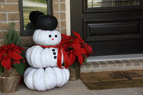 repurposed pumpkins snowmen welcome you to our home this nola at