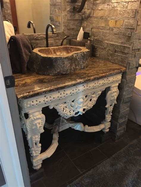 castle world powder room stone floor