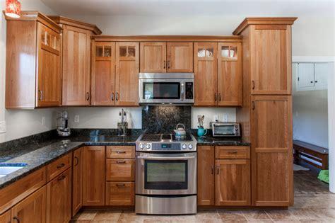 Ideas For Kitchen Countertops And Backsplashes - natural cherry shaker kitchen with dark granite countertops traditional kitchen burlington