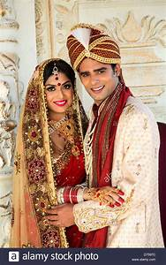 indian bride and groom in traditional wedding dress stock With indian wedding dresses for groom