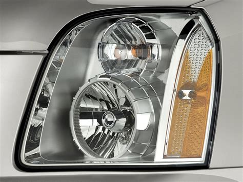 image 2011 gmc yukon 2wd 4 door 1500 denali headlight