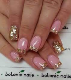Ideas of golden glitter nail paint with plain grey color