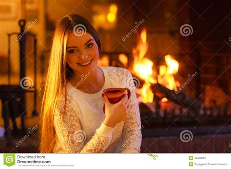 Girl Warming Up At Fireplace Holds Mug Stock Image Samsung Tv Lamp Replacement Stiffel Floor Vintage Clamp Desk Swing Arm Serge Mouille Willow Shades That Fit On Bulb Projector Source Coupon Code Ashley Signature Lamps