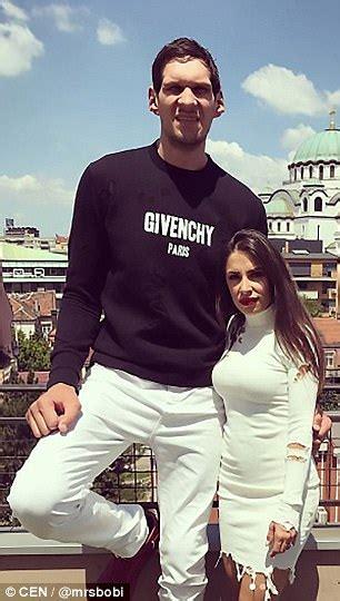 detroit pistons star stands  feet taller   wife