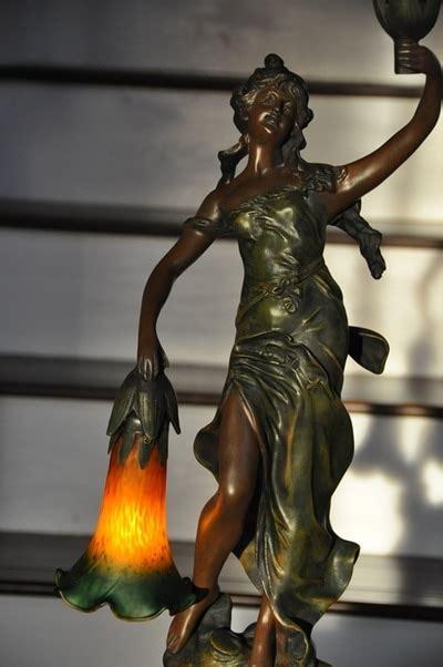 art nouveau style figural lamp   lady holding tulip