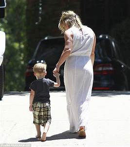 Hilary Duff looks angelic in maxi dress as she carries son ...