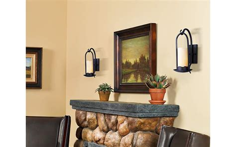 rustic wall sconces brighten  living room fireplace