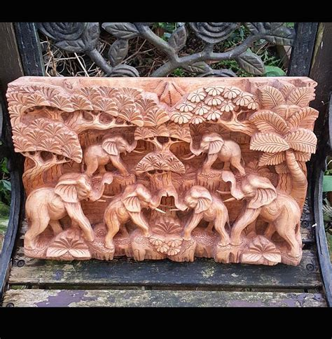 master carved elephant herdhand carved relief wall panel