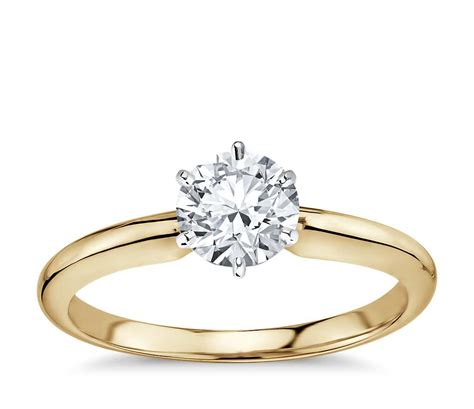 classic six prong solitaire engagement ring in 18k yellow gold blue nile