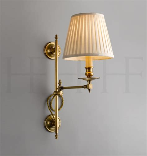 hector swing arm wall light vertically adjustable by